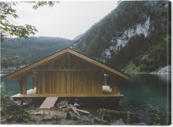 Wood house on lake with mountains and trees Canvas Print