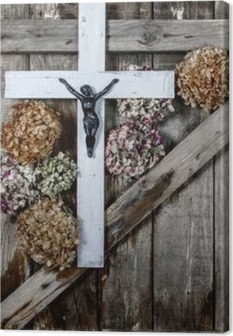 Wooden cross and white hydrangea flower on the background of the old wooden walls Canvas Print