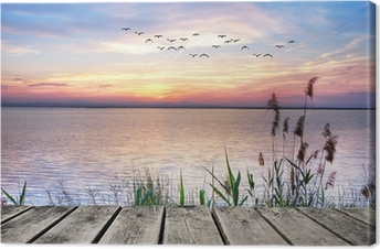 Wooden jetty at sunset Canvas Print