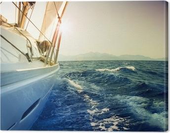 Yacht Sailing against sunset.Sailboat.Sepia toned Canvas Print