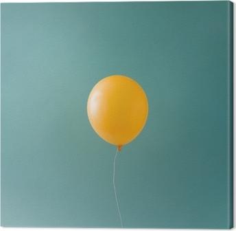 Yellow balloonon blue sky. Minimal concept. Canvas Print