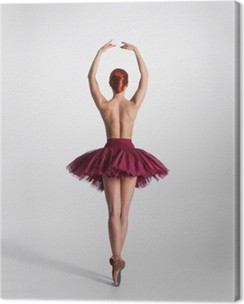 Young naked redhead female ballet dancer in a studio Canvas Print