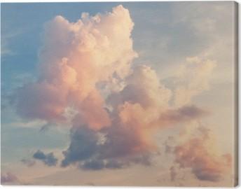 Canvas Roze wolken tegen een blauwe lucht