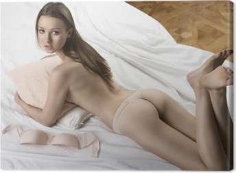 Canvas Sexy naakt meisje liggend op het witte bed met kussen in haar armen