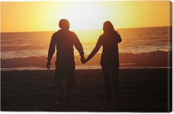 Canvas Verliefde paar strand zonsondergang