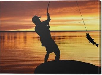 Canvas Visser met een vis vangen op zonsopgang achtergrond