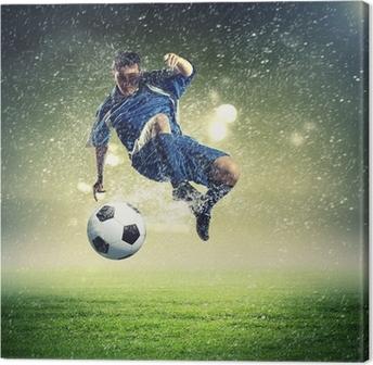Canvas Voetballer de bal te slaan