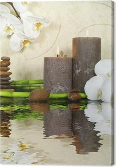Canvas Witte orchidee en bamboe met kaarsen en stenen