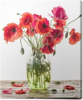 Canvastavla Bukett av vallmo blommor i vas på träbord.