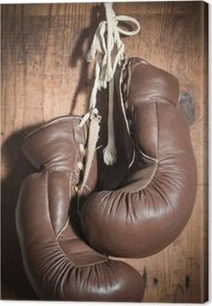 Canvastavla Gamla boxhandskar, hängande på trävägg
