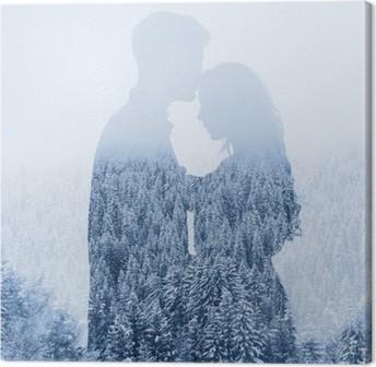 Canvastavla Kärlek på vintern, siluett av par på skog bakgrund, dubbelexponering