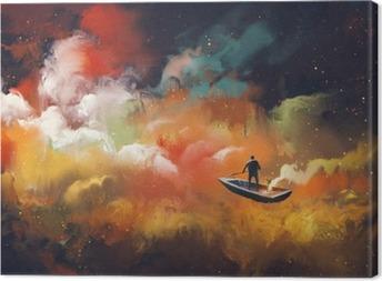 Canvastavla Man på en båt i yttre rymden med färgglada moln, illustration