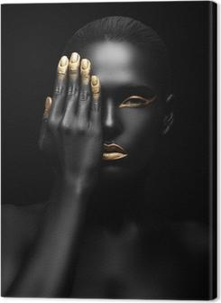 Canvastavla Mörkhyad kvinna med gyllene make-up.