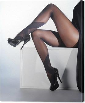 Canvastavla Sexiga kvinnliga ben i svarta erotiska strumpor och höga klackar