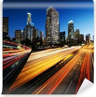 Carta da Parati in Vinile Città di Los Angeles California, al tramonto, con percorsi di luce