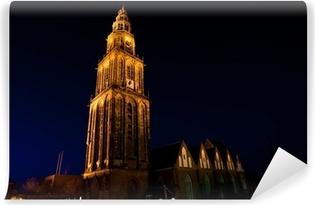 Carta da Parati in Vinile Famoso Martinitoren (torre Martini) a Groningen durante la notte