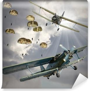 Carta da Parati in Vinile Immagine retrò stile dei biplani con fanteria dispersa nell'aria.