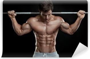 Carta da Parati in Vinile Ragazzo muscoloso bodybuilder facendo esercizi con manubri su bla