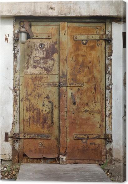 Cuadro en Lienzo Antigua puerta de metal oxidado en una fábrica ...