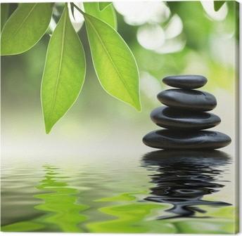 Cuadro en Lienzo Pirámide de piedras zen en la superficie del agua, las hojas verdes sobre ella