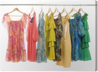 Cuadro en Lienzo Ropa colorida variedad de ropa casual en perchas de madera