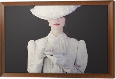 Cuadro Enmarcado Mujer en ropa blanca de la época victoriana con taza de té