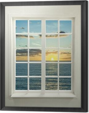 Cuadro Enmarcado Ventana residencial moderno con la puesta del sol sobre el mar y las nubes