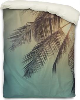 Dekbedovertrek Top van palmboom met zon erachter