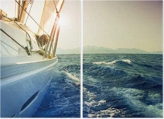 Yacht Sailing against sunset.Sailboat.Sepia toned Diptych