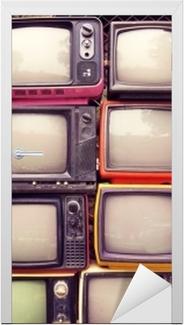 Mønster væg af bunke farverige retro tv (tv) - vintage filter effekt stil. Dør klistemærke