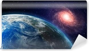 Vinyl Fotobehang Aarde en een spiraalstelsel op de achtergrond