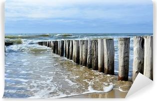 Vinyl Fotobehang Golfbrekers op het strand van de Noordzee in Domburg Nederland