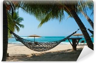 Vinyl Fotobehang Hangmat tussen palmbomen