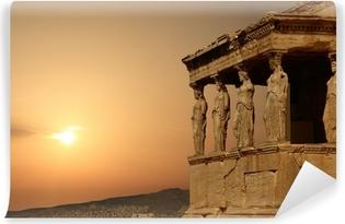 Vinyl Fotobehang Kariatiden op de Atheense Akropolis bij zonsondergang, Griekenland