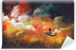 Vinyl Fotobehang Man op een boot in de ruimte met kleurrijke wolk, illustratie