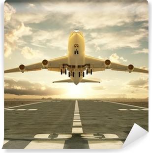 Vinyl Fotobehang Opstijgend vliegtuig bij zonsondergang