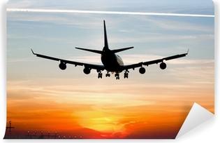 Vinyl Fotobehang Vliegtuig landing bij zonsopgang
