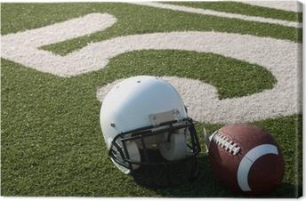 Amerikansk fodboldudstyr på felt Fotolærred