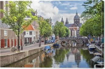 Canal and St. Nicolas Church i Amsterdam Fotolærred