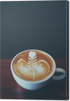 Kop kaffe latte kunst i kaffebar Fotolærred