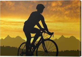 Silhuet af cyklisten kører på en cykel ved solnedgang Fotolærred