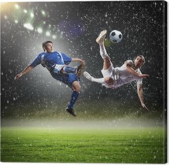 To fodboldspillere slår bolden Fotolærred