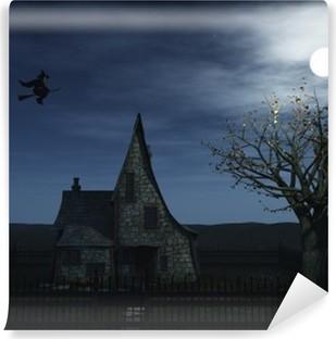 Fotomural Autoadhesivo Una escalofriante casa de brujas y una bruja volando hacia la luna llena.