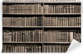 Vinyl-Fototapete Alte Bücher in einer Bibliothek - Sepia Bild