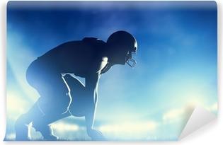Vinyl-Fototapete American-Football-Spieler im Spiel. Stadion Lichter
