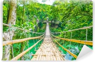 Vinyl-Fototapete Bambus Fußgänger-Hängebrücke über den Fluss