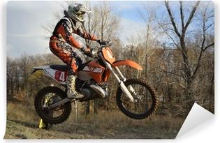 Vinyl-Fototapete Ein Sprung Fahrer auf einem Motorrad Motocross