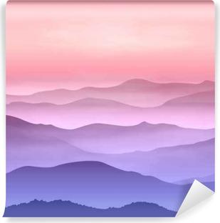 Vinyl-Fototapete Hintergrund mit Bergen im Nebel. Sonnenuntergangzeit.