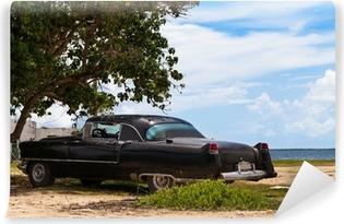 Vinyl-Fototapete Kuba Oldtimer parkend am Strand