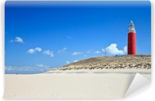 Vinyl-Fototapete Leuchtturm in den Dünen am Strand